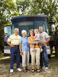 Image of three Generations in front of their Motorhome